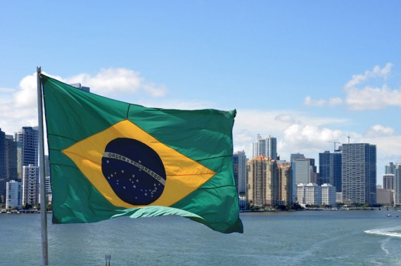 A view of the Brickell skyline from 2009 (Credit: creative commons user MiamiTom) and Brazil's flag (Credit: Max Hendel)