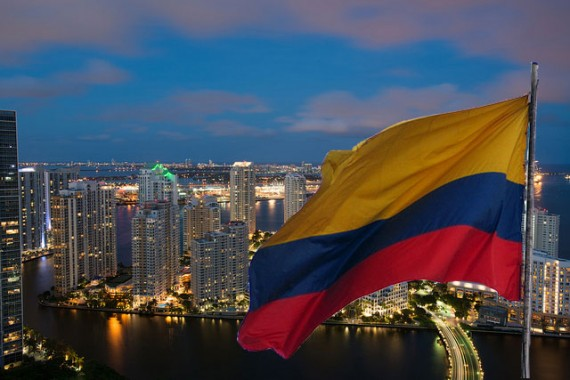 Miami's skyline (Credit: Gabriel Kaplan) and the Colombian flag (Credit: creative commons user ferchos04 II