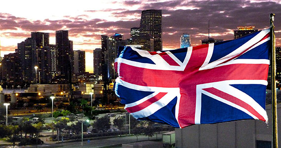 2011 photo of the Miami skyline and the United Kingdom's flag