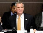 20140929_de_blasio_sitting_feature