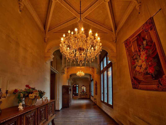 the-original-stonework-paired-with-exquisite-chandeliers-and-rich-tapestries-combine-to-create-a-hallway-that-is-a-treat-to-walk-through