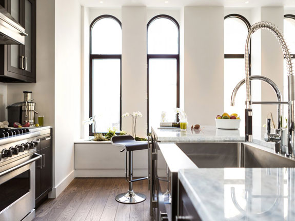 the-kitchen-is-of-course-updated-with-the-latest-in-appliances-and-features-a-huge-oven-and-an-even-bigger-sink-anti-microbial-countertops-are-another-delos-touch