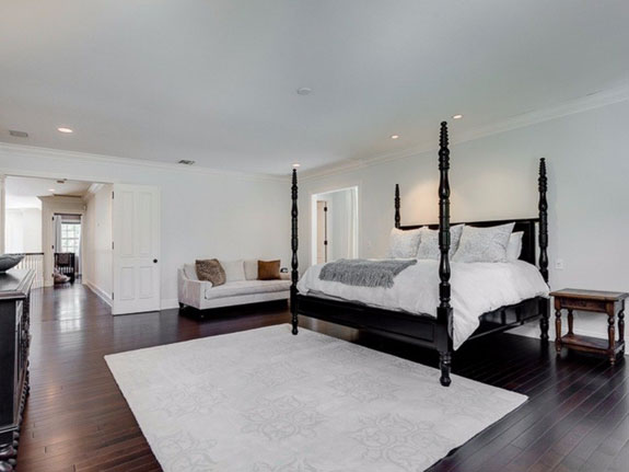 the-oversize-master-suite-features-hardwood-floors-and-a-spacious-airy-layout