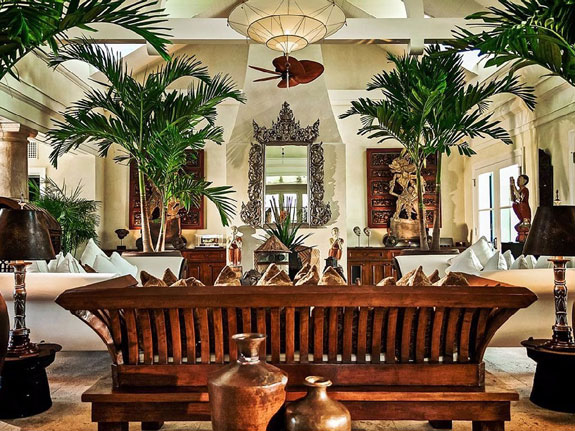the-listing-describes-the-architectural-style-as-english-colonial-with-a-tropical-flair-high-ceilings-and-mahogany-wood-terraces-are-common-features
