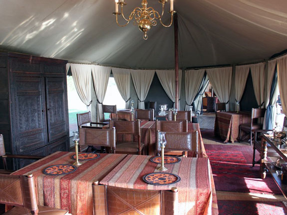 our-dinner-table-was-in-the-dining-tent-but-guests-are-served-dinner-at-tables-set-up-throughout-camp-and-guests-who-stay-several-days-can-expect-to-eat-in-a-different-location-every-night