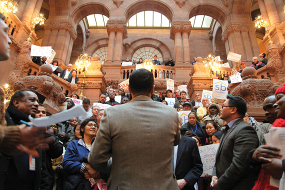 Assemblyman Francisco Moya talking to a crowd at an Airbnb protest in the state capitol building.