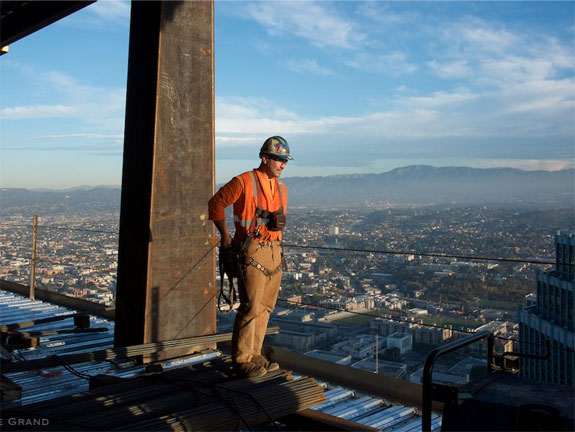 a-construction-worker-stands-on-one-of-the-upper-levels-the-tower-overlooks-the-whole-of-the-city-and-surrounding-mountains