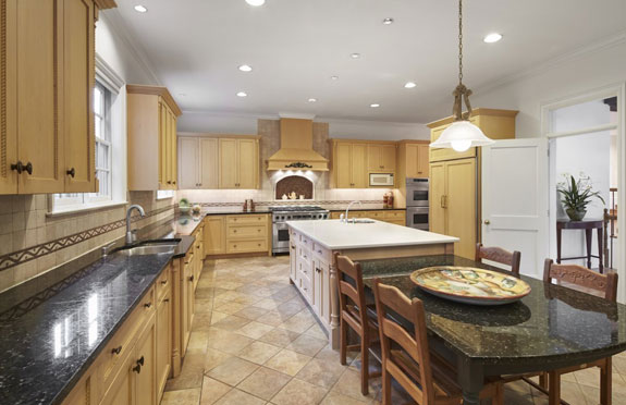 the-kitchen-is-large-complete-with-a-butlers-pantry-granite-counters-and-two-sub-zero-refrigerators