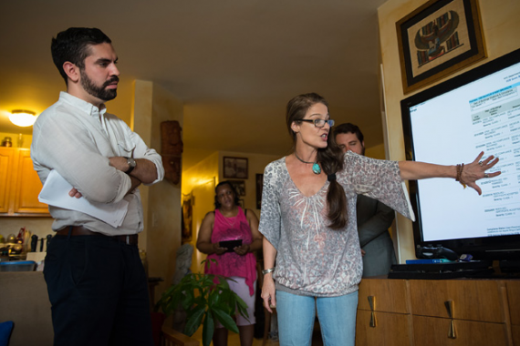 1355 Decatur tenant Lyric Thompson explains code violations to her local City Council member, Rafael Espinal. (Edwin J. Torres for ProPublica)