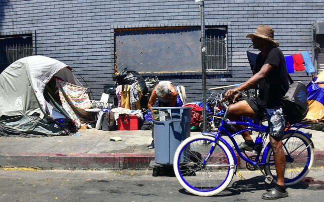 Tents and belongings of the homeless line a street in downtown Los Angeles (Credit: Getty Images)