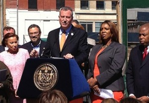 Mayor Bill de Blasio (center), along with Public Advocate Letitia James, Brooklyn Borough President Eric Adams and other officials in Fort Greene during the initial announcement of the housing plan (Credit: Hiten Samtani)