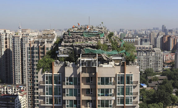 imitation-rocks-on-the-rooftop-of-a-26-story-residential-building-in-beijing-in-august-of-2013-the-elaborate-villa-complete-with-a-garden-was-built-illegally-on-top-of-a-beijing-apartme