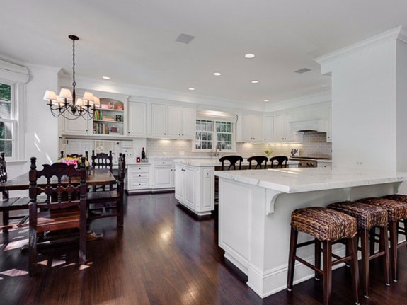 with-two-dishwashers-a-center-island-breakfast-bar-desk-area-and-plenty-of-counter-space-the-gourmet-kitchen-is-a-cooks-dream