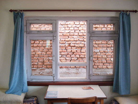 A window opening to a brick wall