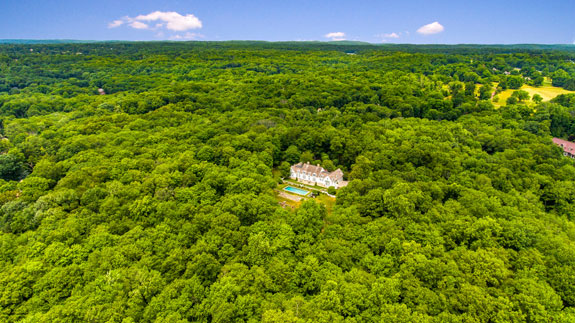 The home is tucked away into a 300-acre nature reserve