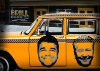 A taxi with portaits of Ilan Bracha and Simon Garber parked outside of the Brill Building at 1619 Broadway (Credit: iStock and Google Maps)